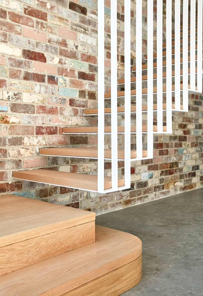 **Palette** Exposed bricks are paired with warm timber and a stark white balustrade to create a dramatic statement staircase.
