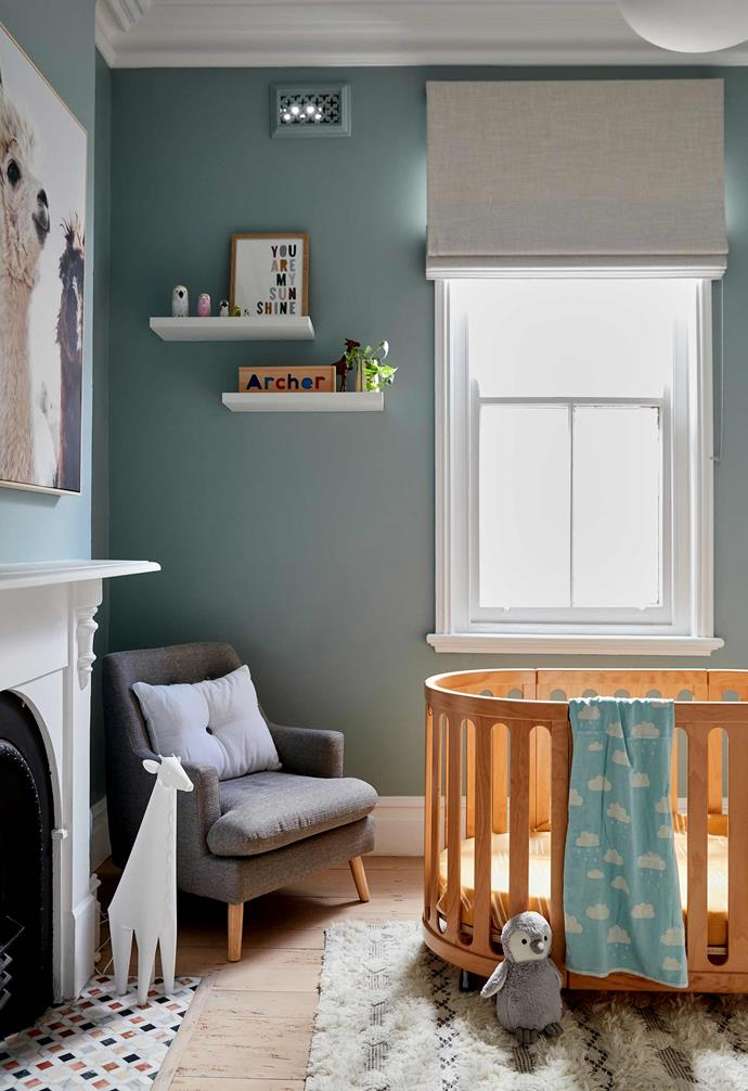 """**Nursery** Painted Napoleon, a soothing shade of green by [Porter's Paints](https://www.porterspaints.com/ target=""""_blank"""" rel=""""nofollow""""), the nursery features a Nest cot from Cocoon Furniture and armchair from [Lounge Lovers](https://www.loungelovers.com.au/ target=""""_blank"""" rel=""""nofollow""""). Mixed marble mosaics on fireplace (replacing damaged originals), [Teranova](https://teranova.com.au/ target=""""_blank"""" rel=""""nofollow""""). Everest rug, [Unitex](https://www.unitex.com.au/ target=""""_blank"""" rel=""""nofollow""""). Mokum fabric blinds, [Divine Designs](https://www.divinedesigns.com.au/ target=""""_blank"""" rel=""""nofollow""""). Llama Friends framed print, [Life Interiors](https://www.lifeinteriors.com.au/ target=""""_blank"""" rel=""""nofollow"""")."""