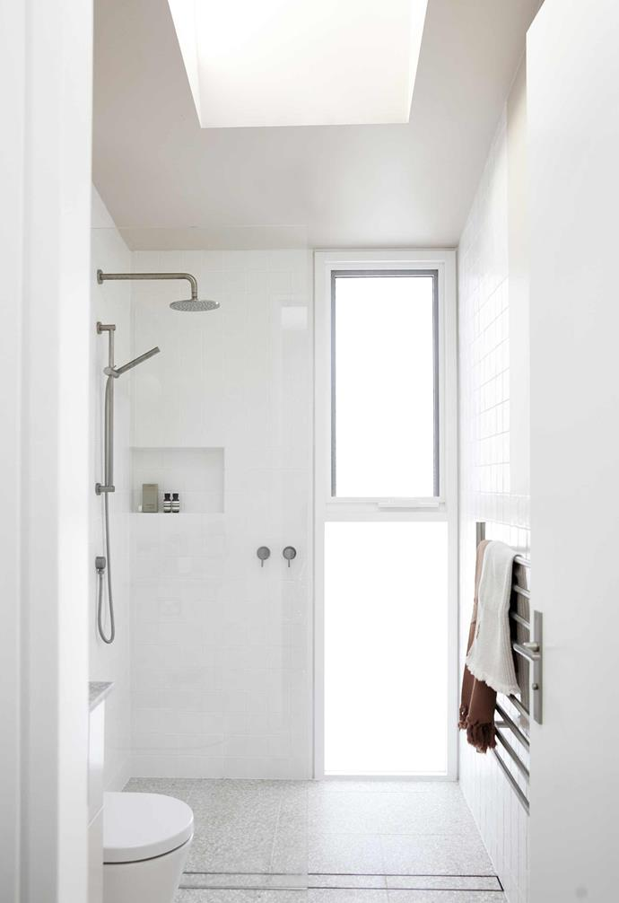 """**Bathroom** Frosted glass and [Dulux](https://www.dulux.com.au/ target=""""_blank"""" rel=""""nofollow"""") Shetland Lace on the walls and ceiling complement the shell-pink terrazzo flooring from [Surface Gallery](https://surfacegallery.com.au/ target=""""_blank"""" rel=""""nofollow""""). Brushed-nickel fittings, [ACS Bathrooms](https://www.acsbathrooms.com.au/ target=""""_blank"""" rel=""""nofollow"""")."""