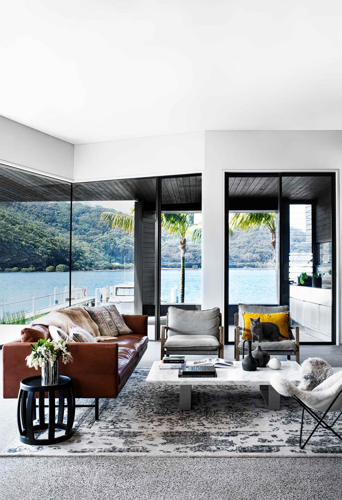 "A beautiful and ornate rug in a neutral palette was the perfect choice to add some warmth and tactility in the living area of this [contemporary abode in Booker Bay](https://www.homestolove.com.au/modern-house-booker-bay-20437|target=""_blank"")."