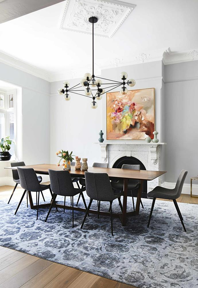 "In the dining area of this [revamped century-old Edwardian home](https://www.homestolove.com.au/a-modern-extension-revived-this-century-old-edwardian-home-7147|target=""_blank""), an ornate rug helps to add a beautiful formal touch to the space."