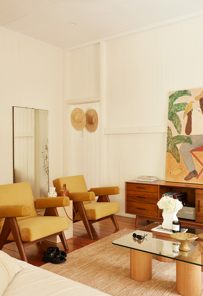 Two Tigmi Trading armchairs in a golden mustard colour evoke nostalgic warmth in the living area.