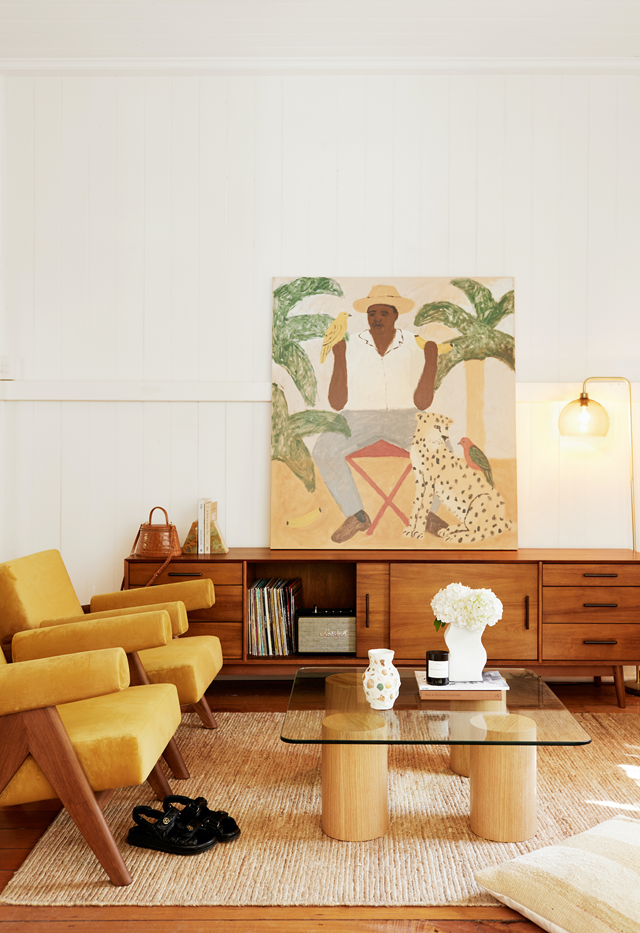 """Colours from nature layered tone-on-tone in [this sunny beachside living room](https://www.homestolove.com.au/beachside-apartment-retro-style-22179