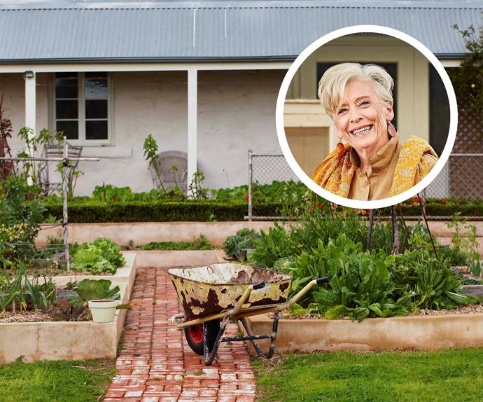 Wheelbarrow on a footpath surrounded by a kitchen garden with a portrait of Maggie Beer inset