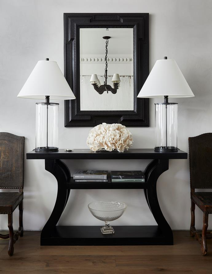 The console in the dining area is from MCM House and is flanked by 19th-century French leather chairs from The Vault Sydney. Lamp bases from Ralph Lauren Home. Dutch ebonised mirror from The Vault Sydney.