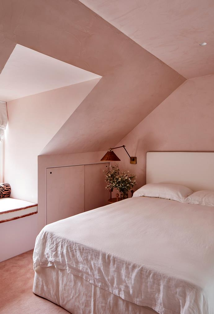 Walls in the guest bedroom are in a custom waxed-pink stucco by Porter's Paints. Custom bedhead by Phoebe Nicol.