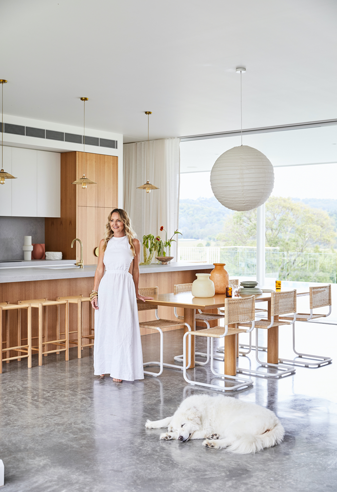 The family of five enjoy casual meals at the Sarah Ellison 'Earth' table with a linen ball pendant from The Society Inc hanging overhead. Among the sculptural ceramics are pieces from Kas Australia, Clo Studios, Nikau Store and Soft Edge Studio. Florals from The Flower Bar.
