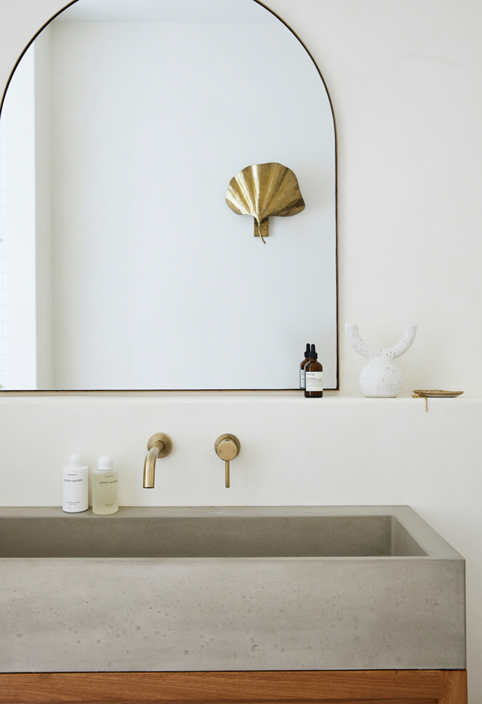 The white ceramic item is from Nikau Store and the Byredo products are from Mecca. Henderson Custom Carpentry created all of the bathroom vanities.