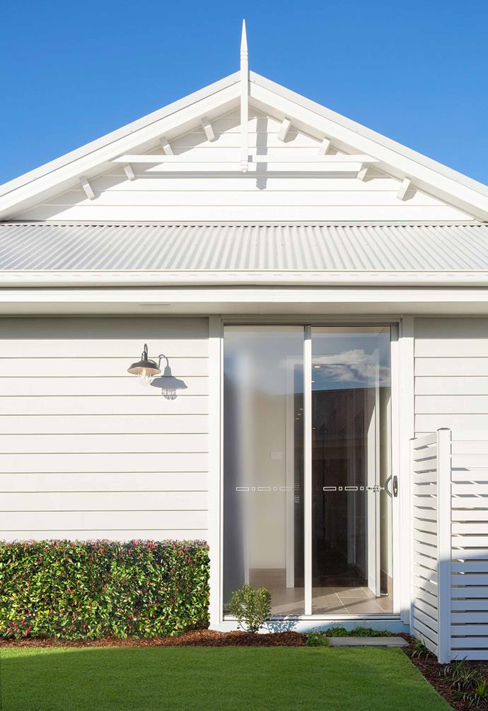 The combination of corrugated iron roofing and white weatherboards adds maximum kerb appeal to the house.