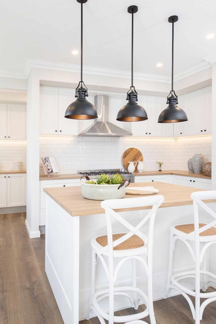 "The statement industrial-style pendant lights that sit over the kitchen island echo the rustic charm of [farmhouse-style homes](https://www.homestolove.com.au/farmhouse-style-interior-ideas-4345|target=""_blank"")."