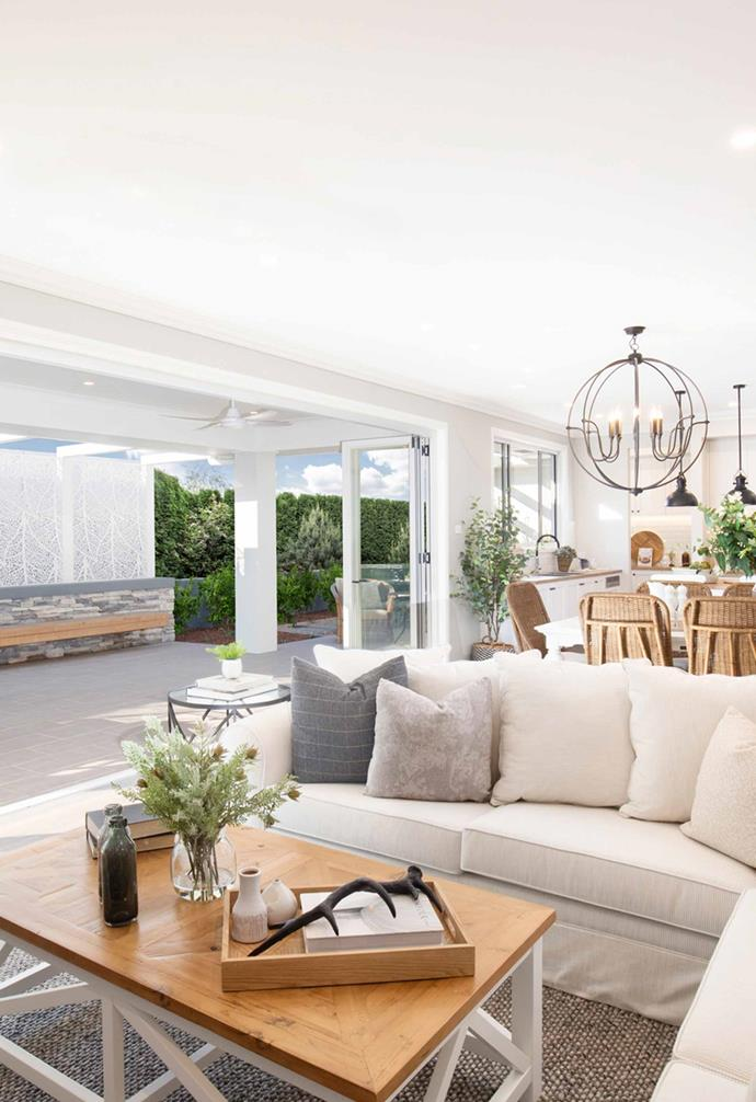 Generous sliding doors connect the heart of the home with the outdoor entertaining zone.