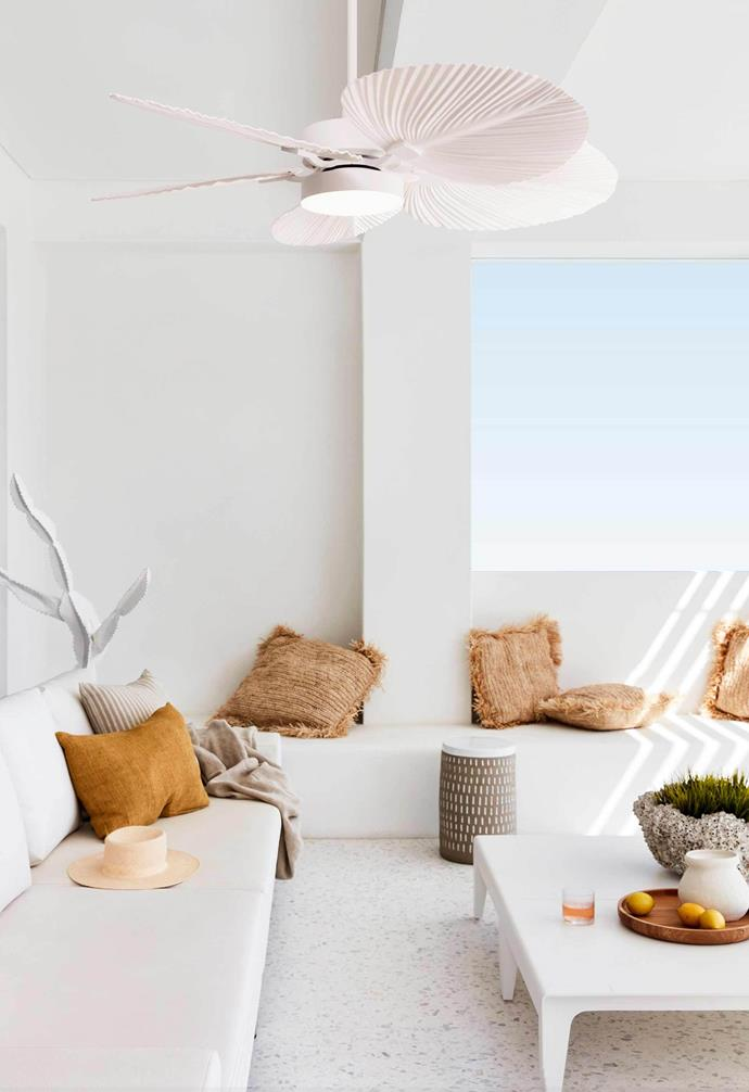 **Coastal cool** The crisp white fan makes a bold statement in this coastal cool living room.