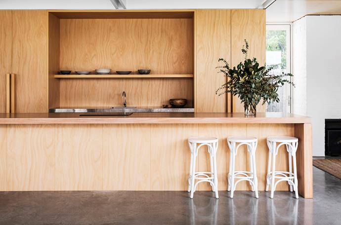 Counter stools from Thonet. The joinery is finished in Navurban Auchen Flower veneer. The island benchtop is made from plywood and timber veneer; the wall-side bench is polished stainless steel. Icon tapware, Astra Walker.