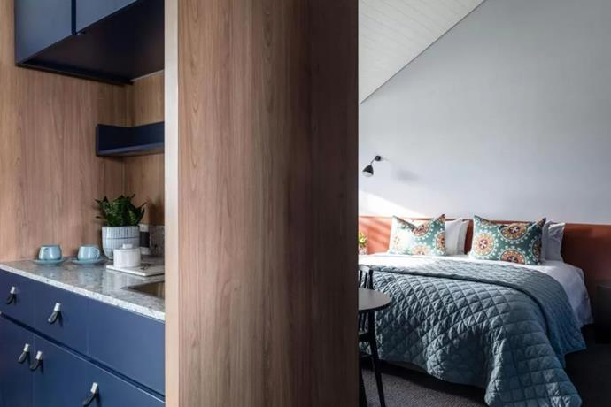 "A glimpse inside a modern room at The Byng Street Boutique Hotel. The rooms were designed by interior designer Louise Spicer of [onefour interiors](https://www.onefourinteriors.com.au/|target=""_blank""