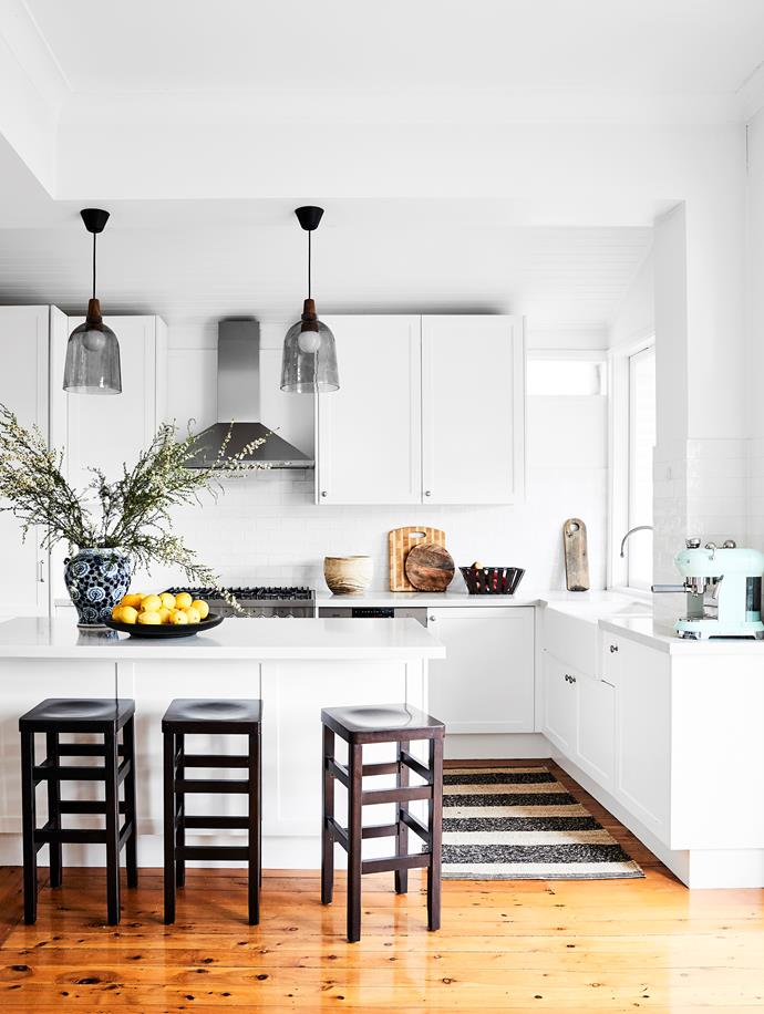 """We change the pendant lights every couple of years to refresh the space,"" says Eugenie. Karma 24 pendants by Antonia Senia for Seidenfaden Design. Caesarstone splashback in Snow. Stools, Thonet. Vase, Orient House. Cooker and dishwasher, Ilve. Coffee machine, Smeg."