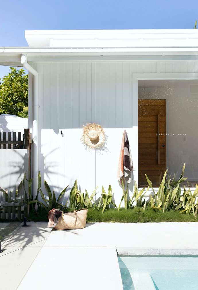 Pared-back landscaping around the pool hints at a tropical getaway.