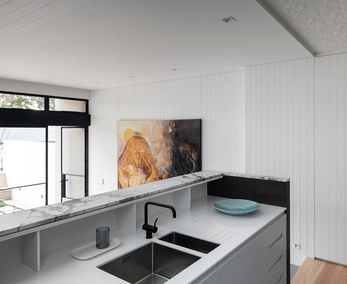 """White' bench surfaces and Barazza 'Cubo' sinks from Abey with Vola 'KV1' mixer. Artwork by Wendy Stavrianos. """"Painted lining boards on walls and ceilings link the new with the old,"""" say the architects."""