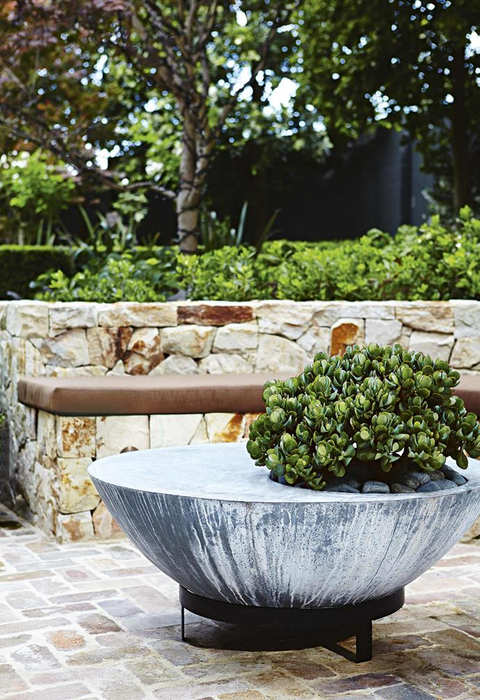 """**Clever planters** """"The planter is from Parterre,"""" says landscape designer Matthew Hook of Outdoor Establishments. """"The hole was intended to be used as an ice bucket, but we drilled drainage holes and converted it into a planter."""""""