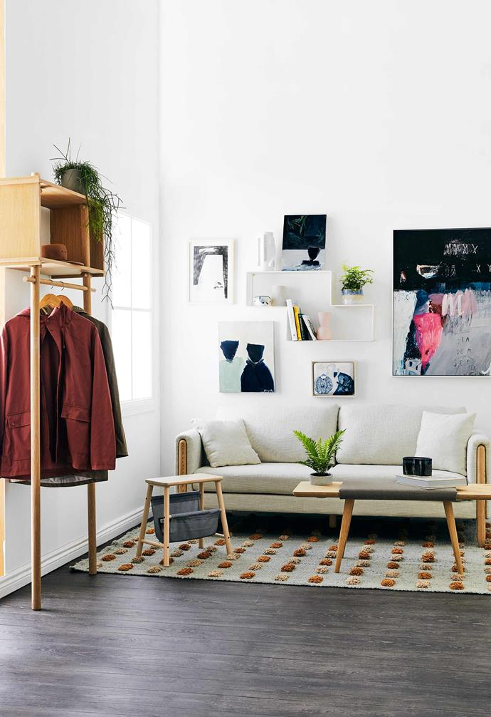 **Upper reach** Part living room, part sleep zone, this multipurpose studio space goes vertical with attractive wall shelves and a stacked clothing rack. Timber details and potted plants tie it all together.