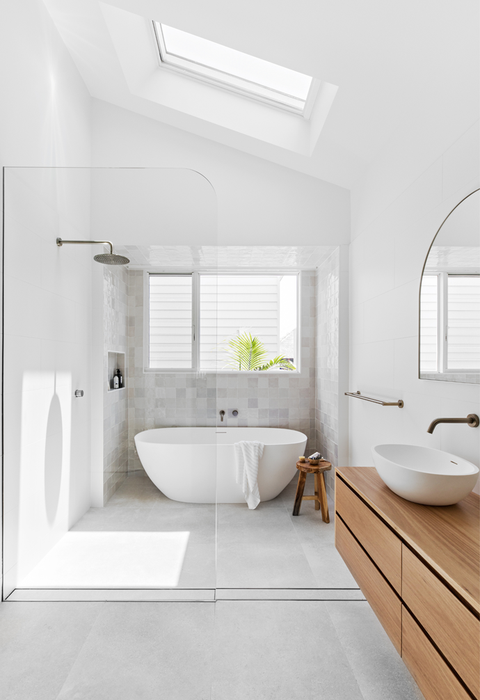 The ensuite bathroom comes together beautifully with smooth lines, soft curves, Moroccan-style tiles and lots of natural light. The bath and basin are Reece, the tapware is ABI Interiors and the vanity is from Wildflower Furniture.