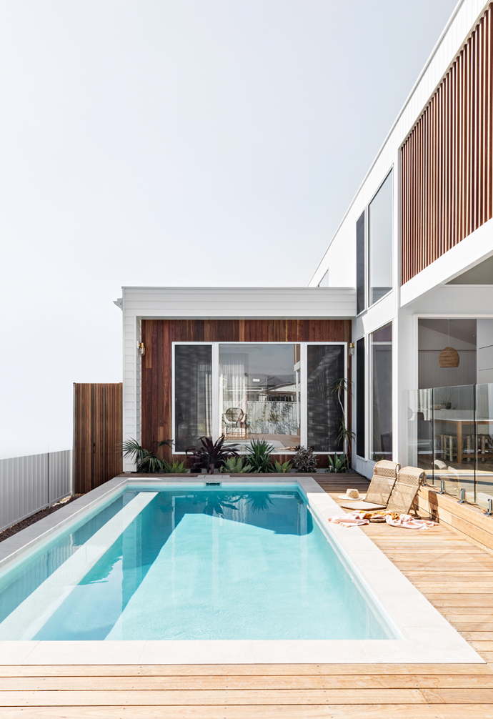 The pool is arguably the heart of Orton Haus. The 7-m glass bead magnesium mineral pool features bull nose concrete-look coping tiles, white mosaic waterline tiles and is framed with a spotted gum timber deck. It's here you'll find the Orton family holidaying at home all summer long.