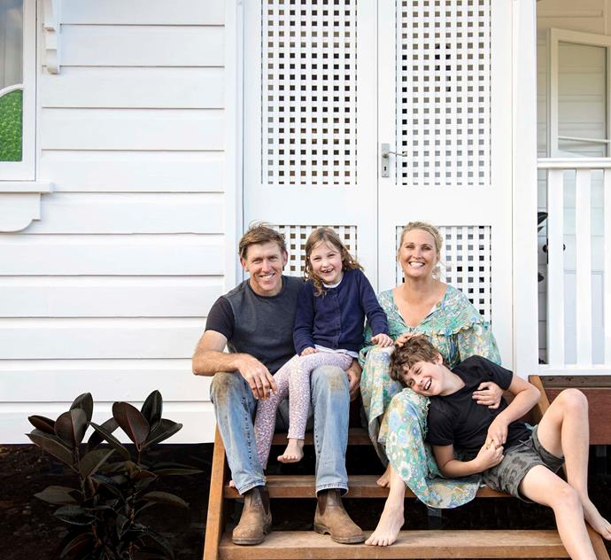 Julie, Sean, and children Tilly and Laird in front of the lattice doors.
