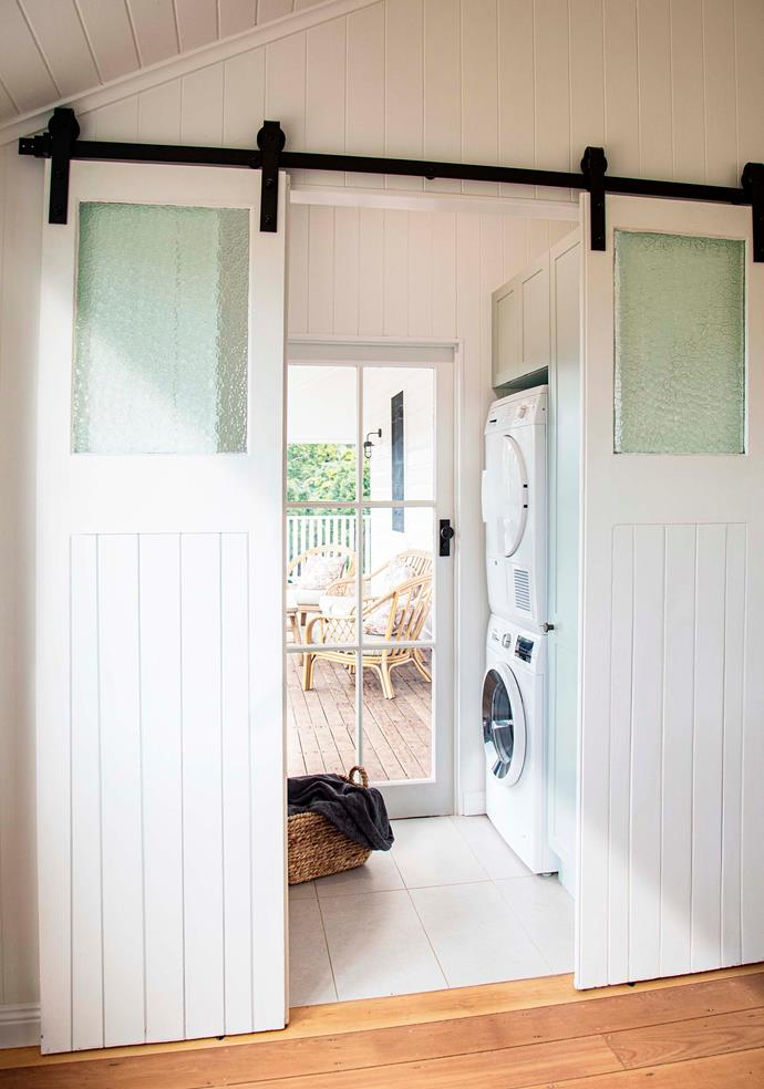 The sliding doors that lead to the laundry were originally hinged doors that Julie and Sean's builder put on a barn door track.