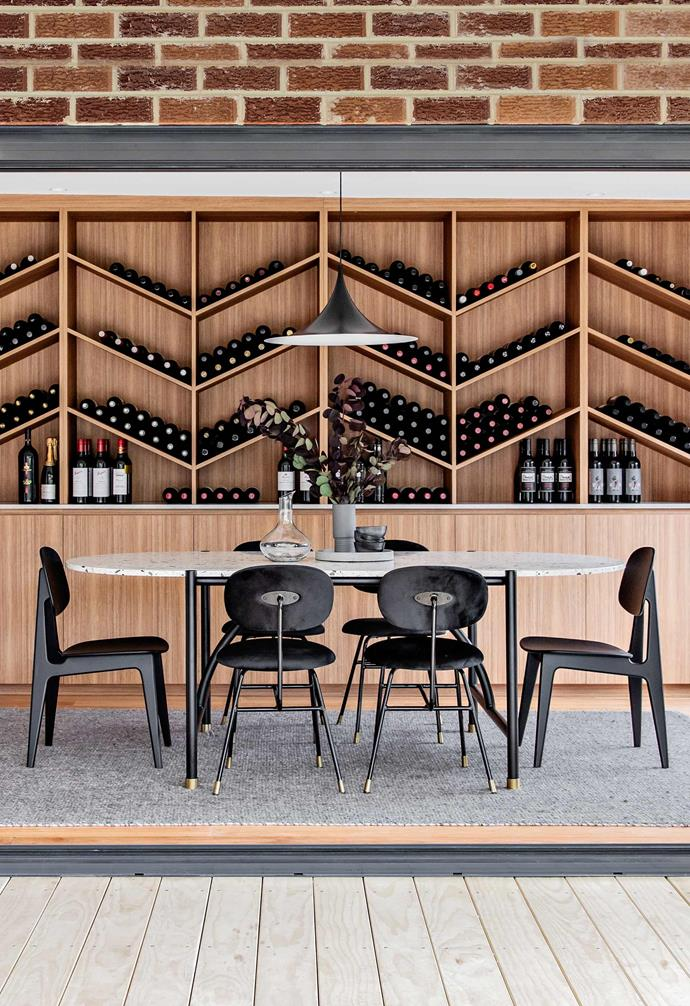 **Key feature** As well as generating shelving and wardrobe spaces for mother and daughter to live more comfortably, Kitty created a sophisticated dining area with chevron-shaped bottle storage that any wine-club president would be proud to show off.