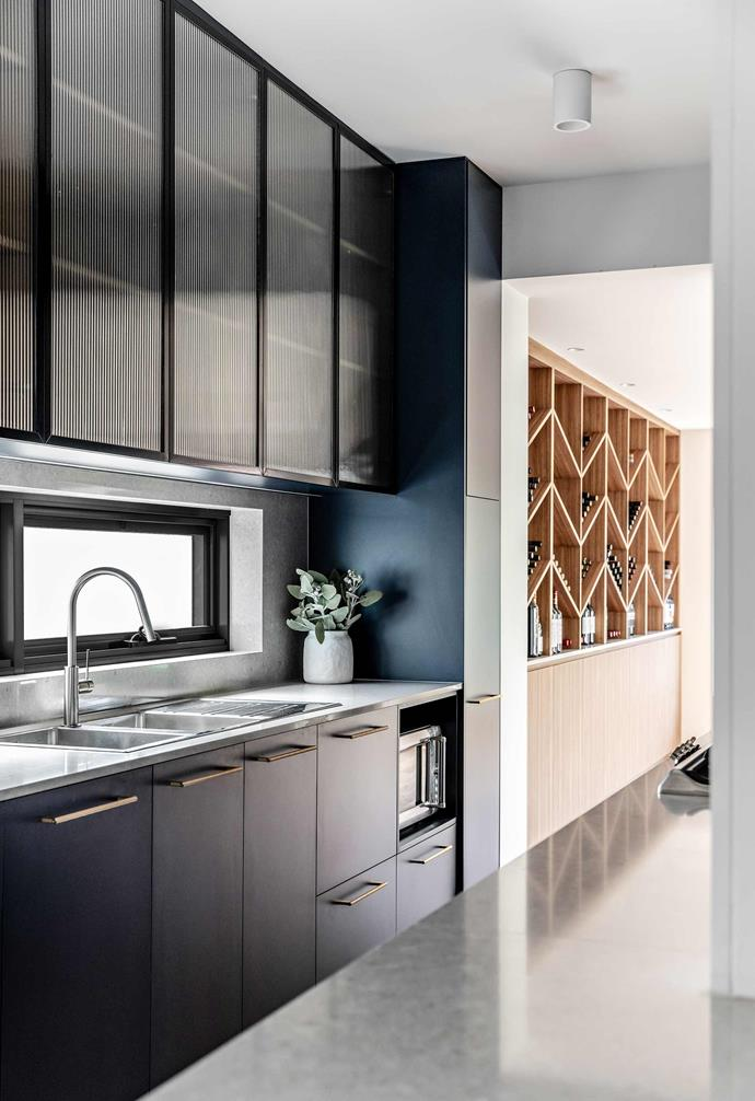 **Details** Flowing on from the entry and kitchen space, it's resplendent in blackbutt with charcoal accents that go perfectly with white or red.
