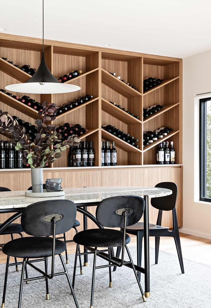 """**Dining room** Chew's wine collection is prominently displayed in the magnificent blackbutt cabinetry. She hosts dinners at the terrazzo-topped Astra table, with guests comfortably seated on Astra dining chairs and Bunny chairs by Curio, all from [Trit House](https://www.trithouse.com.au/