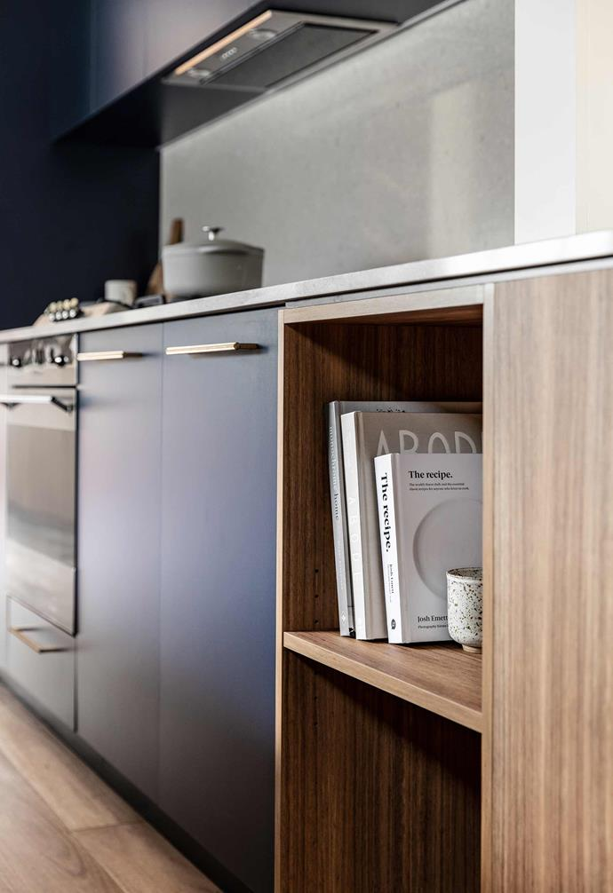 """**Kitchen** The dark midnight-blue joinery is offset by [Quantum Quartz](https://www.wk.com.au/