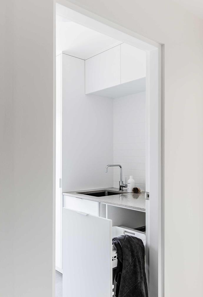 **Laundry** Tucked between the second bedroom and second bathroom, the self-contained laundry room is a welcome alternative to the previous outdoor wash space.