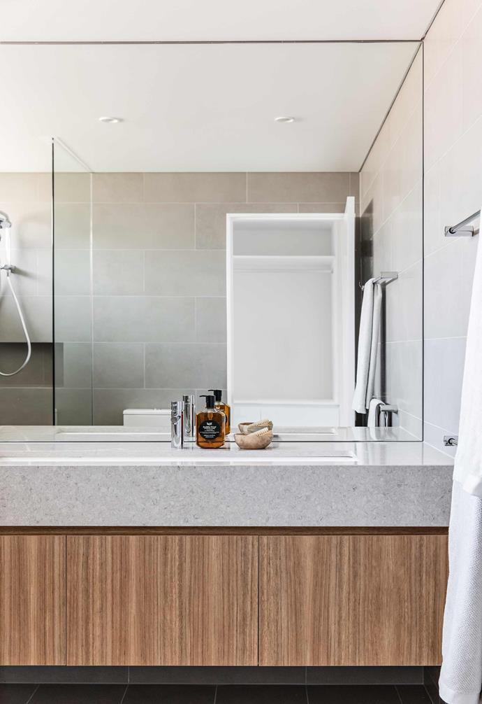 """**Ensuite** A double-width Victoria + Albert sink sits in a slab of [Quantum Quartz](https://www.wk.com.au/