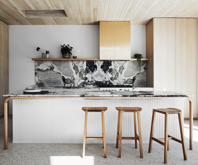 The Signorino 'Ice Green' stone benchtop and splashback add a luxurious element of texture and colour beautifully tempered by smooth Tasmanian oak timber legs made from handrail sections and Tasmanian oak ceiling boards. The owners' Falcon oven was originally black, but because white suited the new colour scheme better, Barkers Burke Construction arranged for a car sprayer to repaint it.