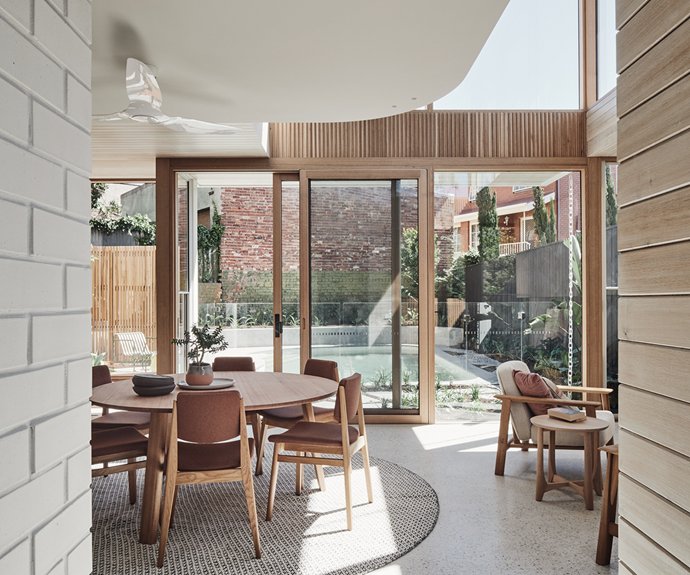 Outdoor views and a great swathe of sky fill the new living space. The beautiful Mud Office-designed garden, which was constructed by Josh Norman Landscapes, includes a reflexology footpath made of large river rocks that encourages the family to go barefoot and recharge.