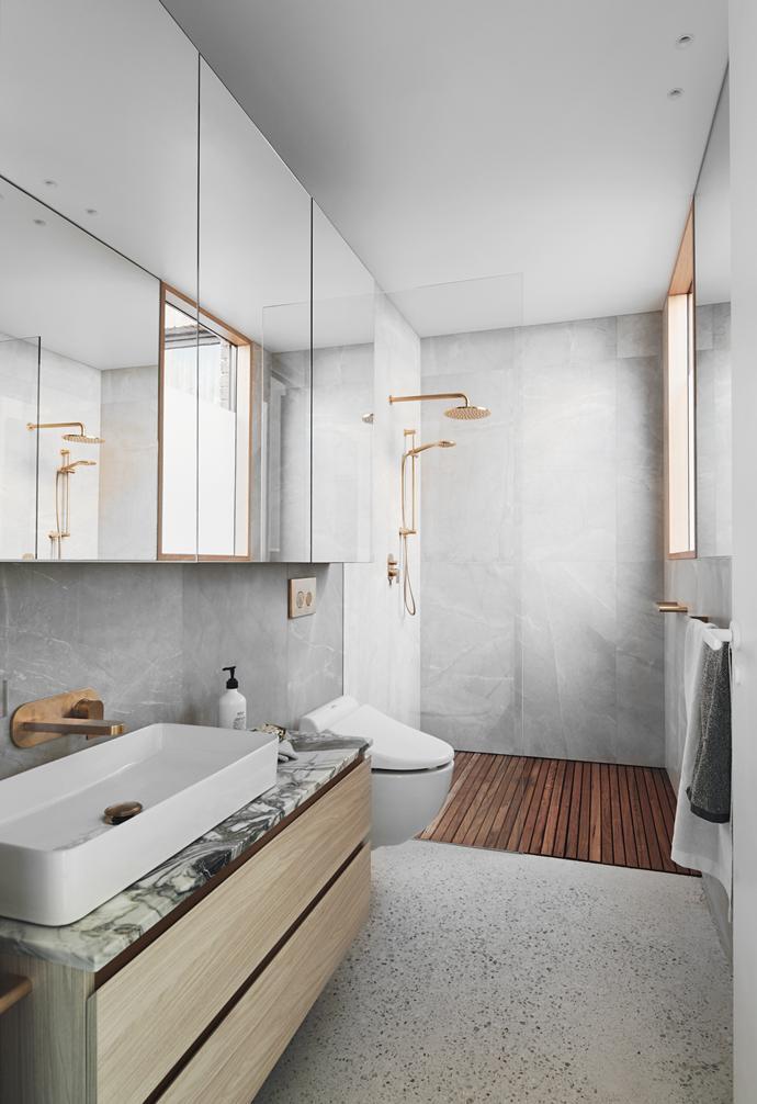 The bathroom is a calming spa-like enclave, thanks to solid ironbark batten flooring in the shower and a bespoke vanity, which is clad in more of Signorino's 'Ice Green' stone with a Rogerseller '60' benchmount basin. The Toto smart toilet is another luxurious feature with its built-in bidet, heated seat and cleaning jets. Astra Walker 'Urban Gold' tapware and showerhead add to the elegant ambience. The soap is from Salus.
