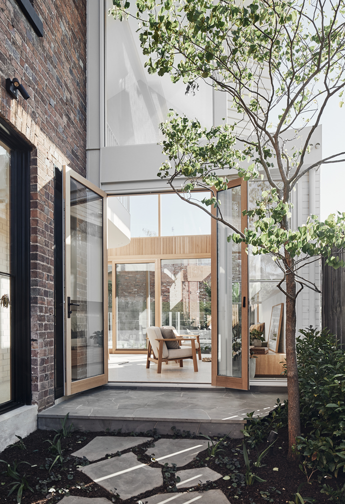 """""""The rear yard feels like part of the living and kitchen space as it's nearly all glass interface,"""" says architect Sally Timmins of the home's new double-height void, which floods the extension with light. Establishing a connection to the outdoors was paramount for the owners – their home has a front and back garden, two courtyards and two small roof gardens."""