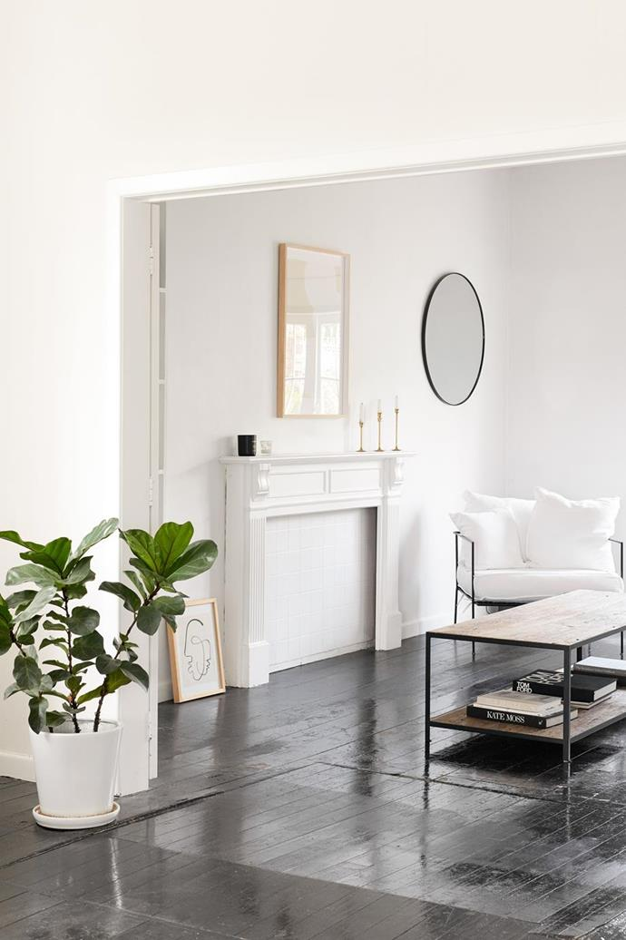 "[Fiddle leaf figs](https://www.homestolove.com.au/tips-for-caring-for-fiddle-leaf-fig-trees-4923|target=""_blank"") love a light and sunny position. Try to avoid dark corners and hot western sun coming in from a window. Avoid air conditioning and blasts of warm air from central heating where you can. Only water when soil is dry to touch. Photographer: Kirsty Dawn"
