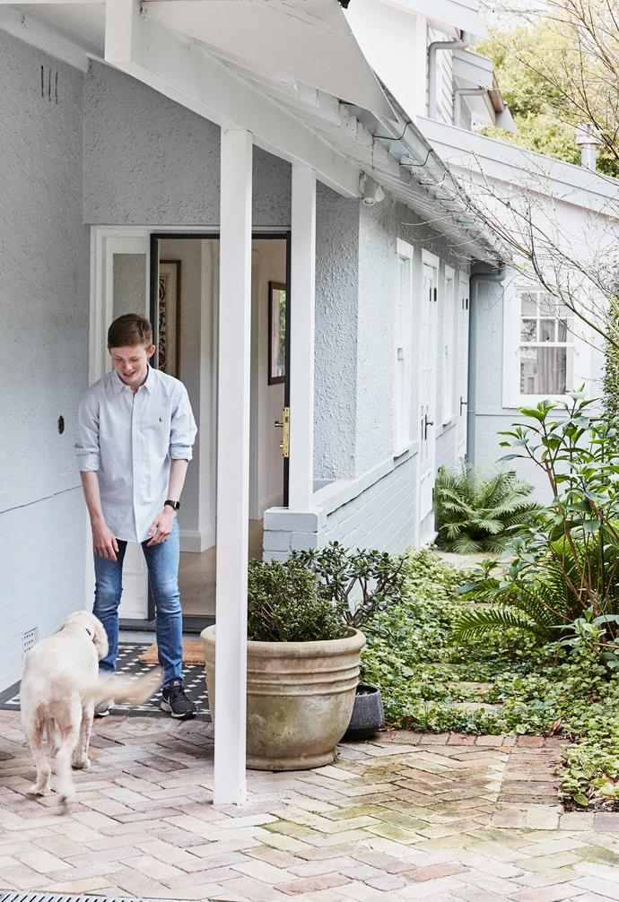 """**Entry** Victoria's son Sam with Otto at the front door. Recycled brick paving and plantings by local company [Ballast Landscape](https://www.instagram.com/ballast.landscape/?hl=en