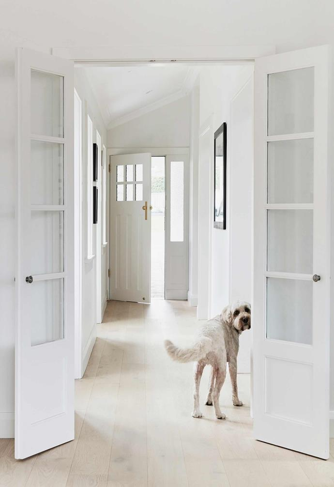 """**Hallway/formal living** """"Interior designer Romy Alwill helped us choose the Freado engineered-oak flooring from [Tongue N Groove](https://tngflooring.com.au/