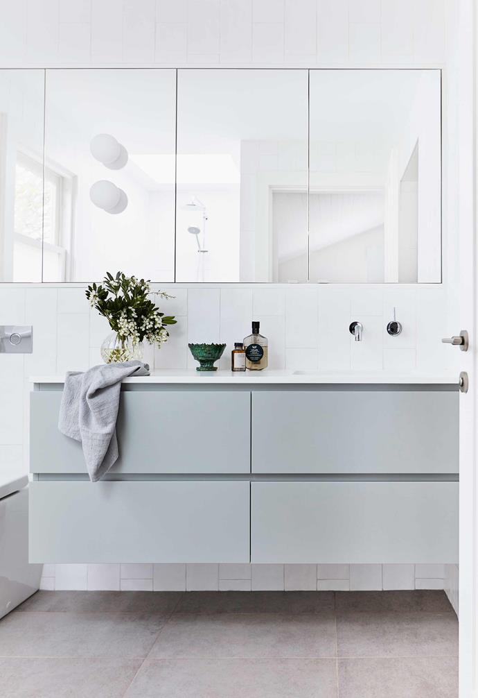 """**Ensuite** Mounted on the mirror are Flos 'Mini Glo Ball' lamps from [Euroluce](https://euroluce.com.au/