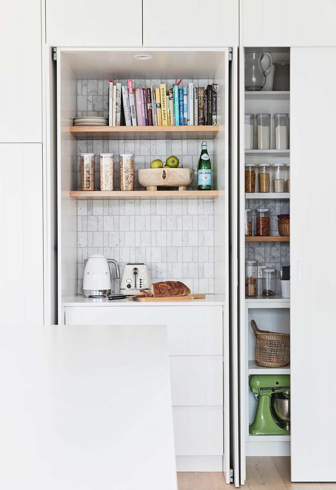 """**Kitchen** At one end of the island, a pantry and appliance cupboard offers bulk storage. Kettle and mixer, [Smeg](https://www.smeg.com.au/