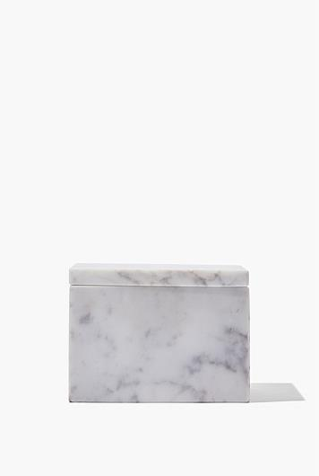 """Loft Storage, $49.95, [Country Road](https://www.countryroad.com.au/loft-storage-60224500 target=""""_blank"""" rel=""""nofollow"""") <br><br> This minimal marble box is the ideal storage box for any home, no matter it's interior style. Crafted from solid Calcutta marble and boasting enough space for treasured jewellery and precious tokens, it's a practical and sleek gift for a loved one that won't go out of fashion."""