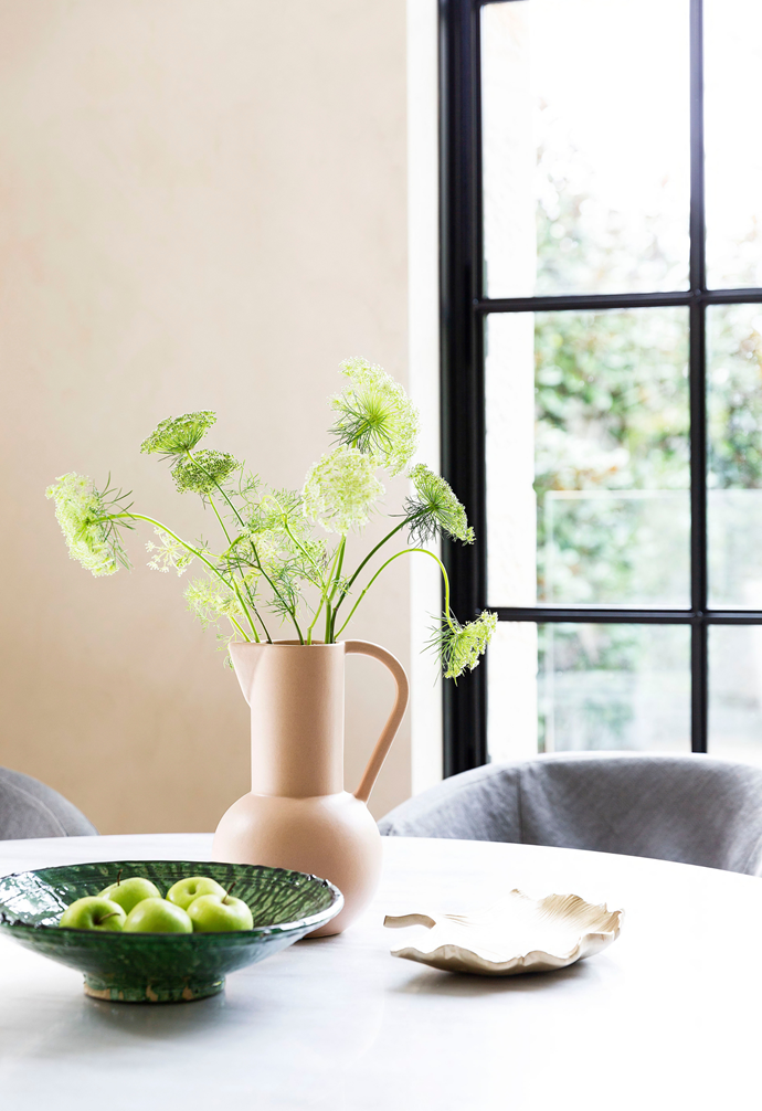 Lou mixes one-off pieces with chain-store finds: this group features a green bowl picked up in Morocco.