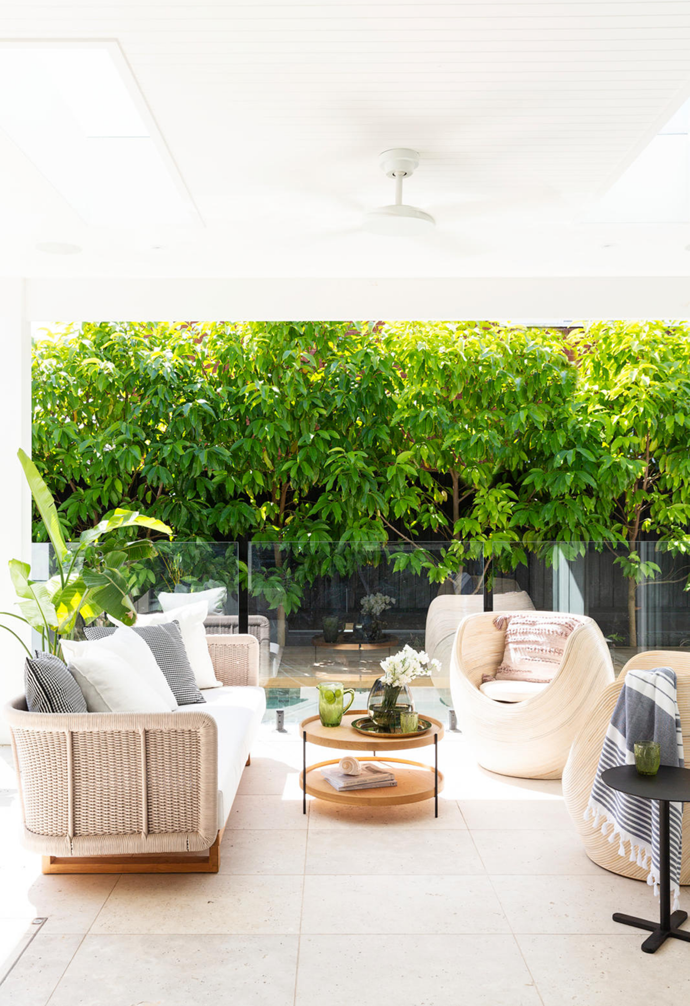 """Guests are drawn outside, where the furniture is often rotated between the poolside and the courtyard. """"These areas give us the flexibility we like,"""" says Lou. By-the-water lounging is delivered by the 'Norfolk' sofa from Smithmade and a coffee table from Globe West while a Smithmade 'Club' tub chair in the courtyard  is a tonal match for sandstone sourced from Gosford Quarries."""