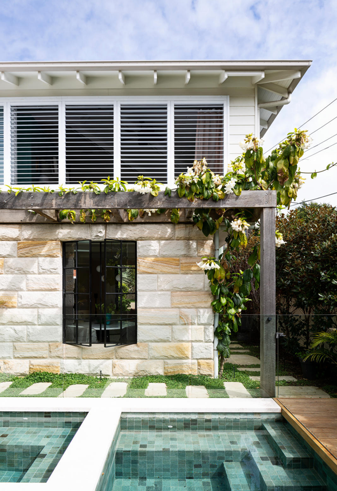 Recycled blackbutt decking finished in Cabot's Beach House Grey leads to an enclosed shower and adds to the vibe. The pergola was made of recycled timber, supplied by Ironwood and fabricated by Planbuilt.