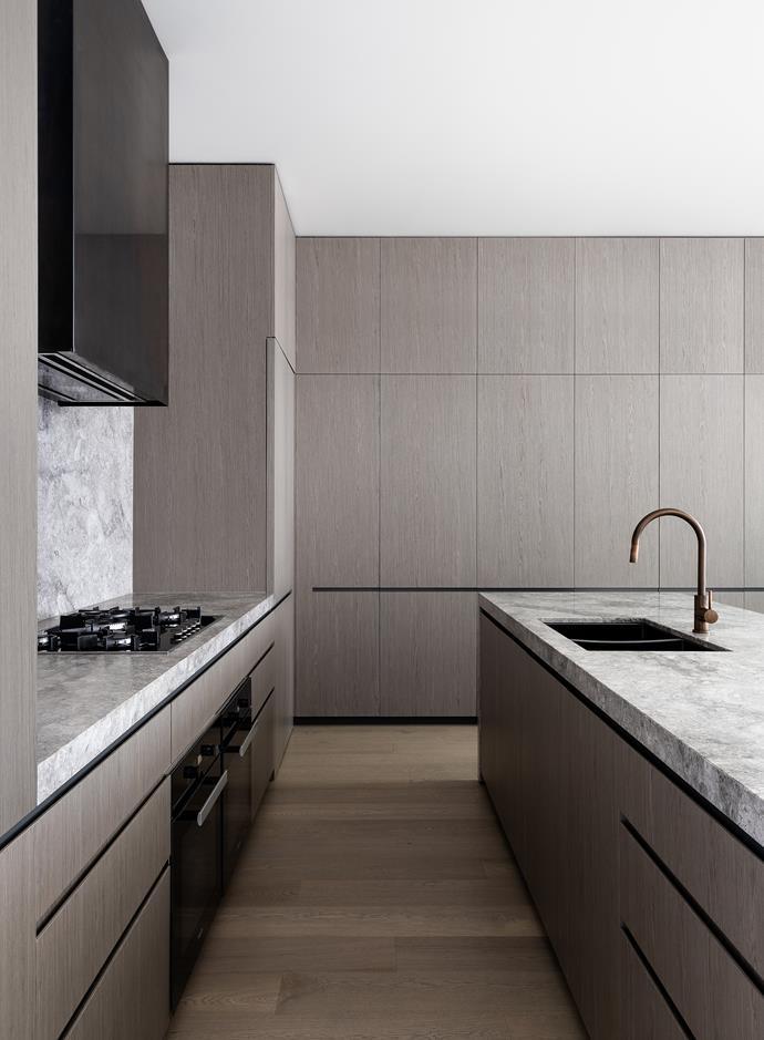 The generously-sized kitchen boasts a a crisp, modern sensibility.