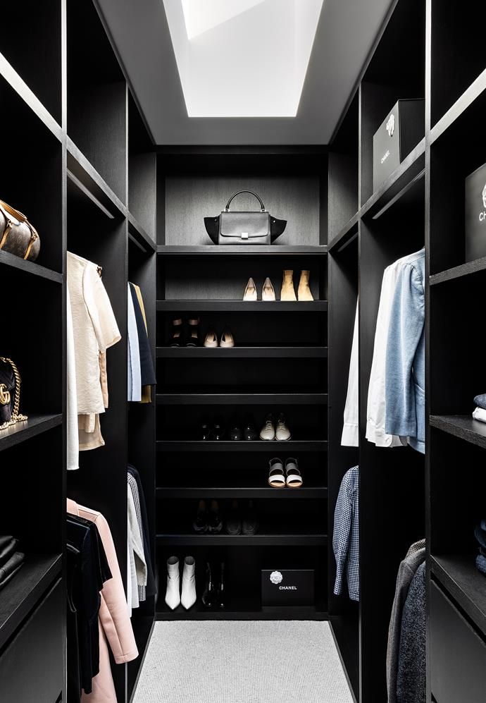 A stylish and moody wardrobe is a luxurious addition to the main bedroom suite.