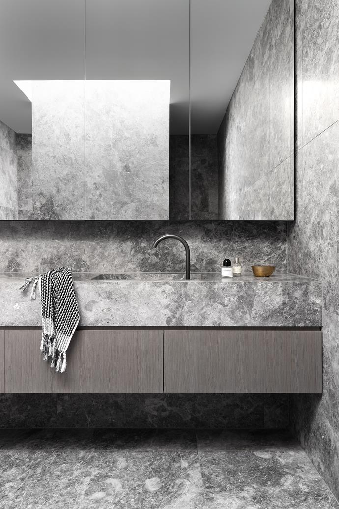 Swathes of marble add a glamorous and timeless appeal to the bathroom.