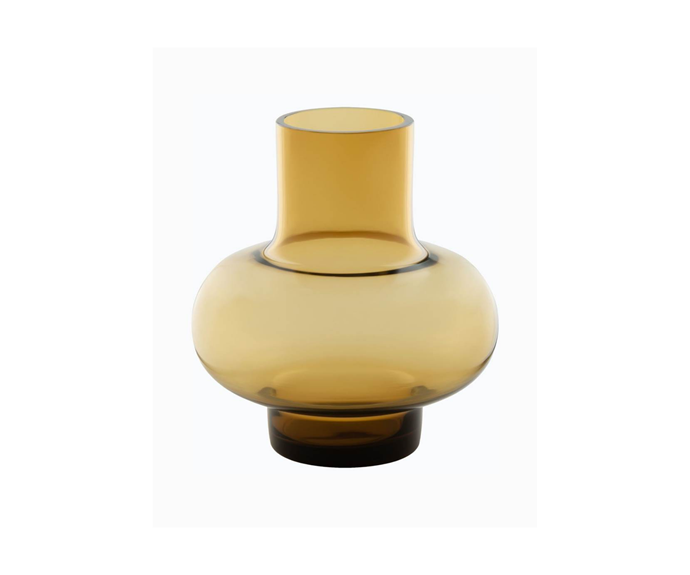 """Umpu Vase in Amber, $185, [marimekko](https://www.marimekko.com/au_en/home/new-in/umpu-vase-amber-070942-200 target=""""_blank"""" rel=""""nofollow"""") <br><br> A unique vase that's equally as beautiful with or without flowers in it is a favourite amongst all design lovers, and this glass, amber hued one from marimekko will take the spotlight in any room."""